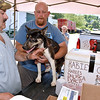 "(Brad Davis/The Register-Herald) Sophia resident Bill Wood hoists Lucky, his nine-month-old husky and German shepherd mix, up onto the tailgate so Robert Howerton, a vet's assistant with Beckley Veterinary Hospital, can give him any required vaccines needed at the traveling Raleigh County Anti Rabies Clinic Saturday afternoon in the Sophia city parking lot. The Raleigh County Assessor's office will travel to towns all over the county for the next week and a half from Monday through Saturday offering a variety of vaccines at the cost of only the vaccines, which can save hundreds of dollars. Go to  <a href=""http://www.raleighcountyassessor.com"">http://www.raleighcountyassessor.com</a> or call 304-255-9178 for when they'll be in your area."