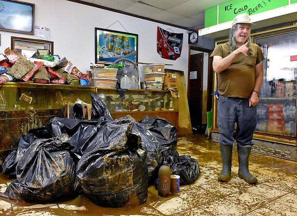 (Brad Davis/The Register-Herald) Vickie's Market's Cornell DeGregory describes his ordeal the night his store flooded Saturday morning in Richwood.