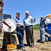 (Brad Davis/The Register-Herald) Walt Helmick (2nd from right), Commissioner of the West Virginia Department of Agriculture, visits with Guyan Conservation's Bill Stewart (2nd from left), active duty National Guardsman Tony Johnson (far right) and his son Devin (far left) as they prepare to begin planting during a Register-Herald visit to the historic potato farm June 8.
