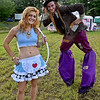 (Brad Davis/The Register-Herald) The stilt-walking Mad Hatter and Alice, also known as Springfield, Missouri's Ryan Hobson and Merisa Vernoy Friday evening at Mountian Music Festival.