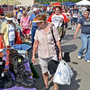 (Brad Davis/The Register-Herald) A host of bargain shoppers browse items during the 21st Annual Newspapers in Education Flea Market & Live Auction Saturday morning in the Marquee Cinemas parking lot.