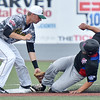 (Brad Davis/The Register-Herald) West Virginia shortstop Paul Trick tags out Champion City's Matthew Furuto as he tries to steal second Sunday afternoon at Linda K. Epling Stadium.