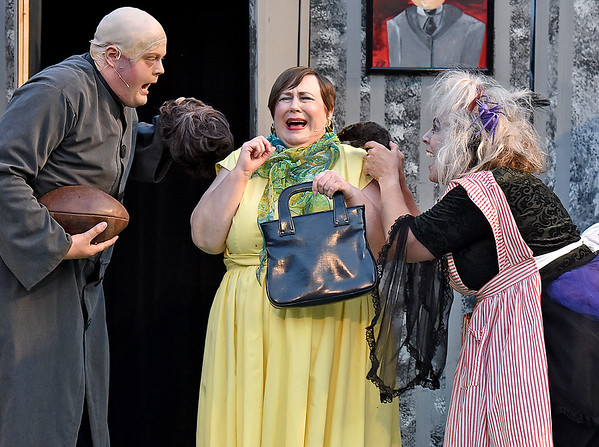 """(Brad Davis/The Register-Herald) It gets a little creepy during pre-dinner introductions as Lucas' mother (middle, played by Deb Brady), the boy trying to court Wednesday, gets a close greeting from Uncle Fester (played by Dan Hasty) and Granny (played by Sharon Chadwick) during Theatre West Virginia's season-opening performance of """"The Addams Family Musical"""" Saturday night at Grandview Park's Cliffside Amphitheatre."""