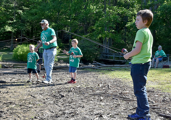(Brad Davis/The Register-Herald) Ten-year-old Russell Jackson, far right, waits for something to bite during the Kids Fishing Derby Saturday morning at Little Beaver State Park.