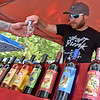 (Brad Davis/The Register-Herald) Fairmont-based Heston Farm's Josh Clarke purs samples of their wine during Daniel Vineyards' annual Spring Wine Festival Saturday afternoon in Crab Orchard.