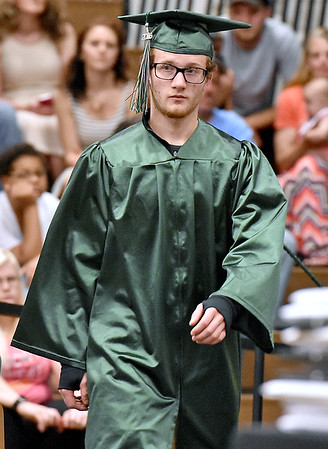 (Brad Davis/The Register-Herald) Graduating Wyoming East senior David Sizemore walks the stage to collect his diploma during the school's 2016 commencement ceremony Sunday afternoon in New Richmond.