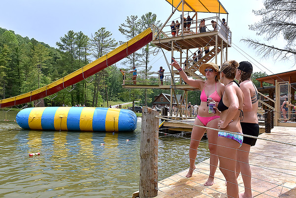 (Brad Davis/The Register-Herald) Festival-goers hang out by the lake during the final day of the Mountain Music Fest Saturday afternoon at Ace Adventure Resort.