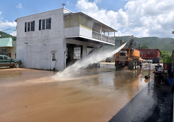(Brad Davis/The Register-Herald) Saturday in Richwood following Thursday's historic flooding.