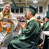 (Brad Davis/The Register-Herald) A graduating Wyoming East senior is all smiles as she collects her diploma during the school's 2016 commencement ceremony Sunday afternoon in New Richmond.