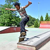(Brad Davis/The Register-Herald) Beckley resident Jay Orr holds his balance as he practices ledge grinds on his skateboard Wednesday afternoon at Freedom Skate Park. The 16-year-old Orr skated regularly for about three years before putting his board down for a while and said he's just getting back into it, taking advantage of near perfect weather yesterday as he practiced grinds on the park's ledge, kick flips off flatland and the occasional up and down off the vert ramps.
