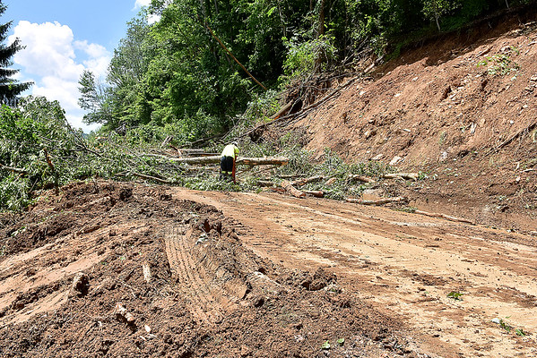 (Brad Davis/The Register-Herald) Cleanup efforts on West Main Street Saturday in Richwood following Thursday's historic flooding.