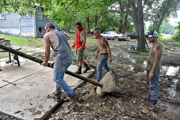 (Brad Davis/The Register-Herald) Saturday in Richwood following Thursday's historic flooding.