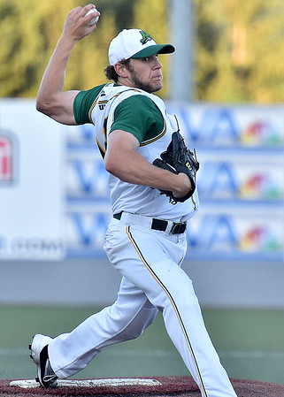 (Brad Davis/The Register-Herald) West Virginia starting pitcher Brian Cherrington delivers against Champion City Saturday night at Linda K. Epling Stadium.