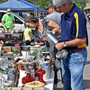 (Brad Davis/The Register-Herald) Whitesville resident Glenn Duncan, near, and a host of other bargain shoppers browse items during the 21st Annual Newspapers in Education Flea Market & Live Auction Saturday morning in the Marquee Cinemas parking lot.