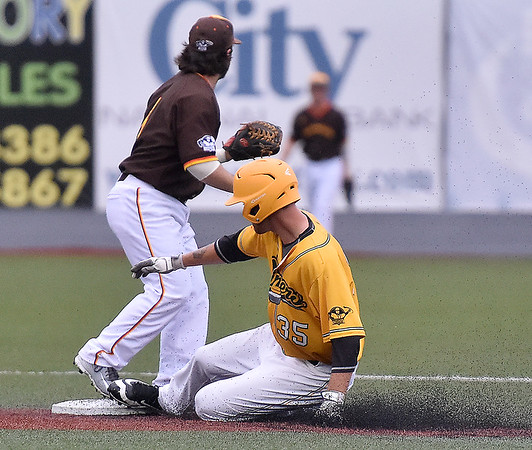 (Brad Davis/The Register-Herald) West Virginia's Tanner Levine slides into second with a double early in the Miners' win over the Kokomo Jackrabbits Friday night at Linda K. Epling Stadium.