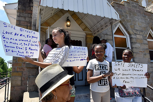 (Brad Davis/The Register-Herald) From left, Alexis Kidd, 13, Journey Moore (hidden behind Alexis), 9, Alia Leftwich, 11, and Keelah Kidd, 12, were among many gathered for Welcome Baptist Church's March for Safe Streets Saturday afternoon.