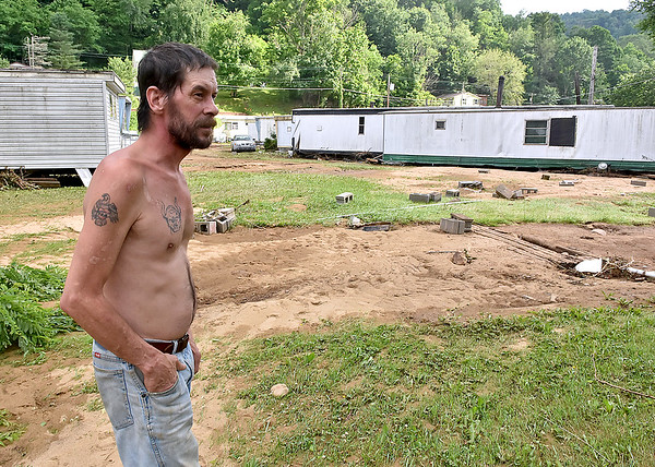 (Brad Davis/The Register-Herald) Jerry Lee, a Richwood resident for over 20 years, said he's never seen flooding of this magnitude before, as he discusses Thursday's disaster where a mobile home, photograped at nearest right, was washed from its foundation.