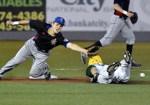 (Brad Davis/The Register-Herald) West Virginia's Sean David Clark steals second as the throw gets past Champion City second baseman Cale Dineen Saturday night at Linda K. Epling Stadium.