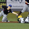 (Brad Davis/The Register-Herald) West Virginia's Sean David Clark steals second as the throw gets past Champion City second baseman Cale Dineen Saturday night at Linda K. Epling Stadium.