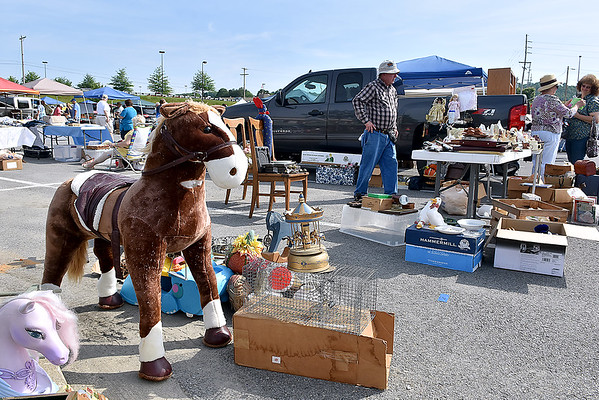 (Brad Davis/The Register-Herald) The 21st Annual Newspapers in Education Flea Market & Live Auction Saturday morning in the Marquee Cinemas parking lot.