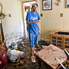 (Brad Davis/The Register-Herald) With his rented house ruined and full of mud, Brooks resident James Graham describes the route he and his family waded through to escape their flooding home through a window in the living room, situated (unphotographed) directly behind the camera.