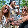 (Brad Davis/The Register-Herald) Beckley residents Amanda McKinnon, left, and Ashley Sodosky offer a cheers to the camera as Drew Lawrence takes in the fine aroma of locally made wine during Daniel Vineyards' annual Spring Wine Festival Saturday afternoon in Crab Orchard.