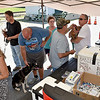 "(Brad Davis/The Register-Herald) Sophia residents utilize the traveling Raleigh County Anti Rabies Clinic Saturday afternoon in the Sophia city parking lot. The Raleigh County Assessor's office will travel to towns all over the county for the next week and a half from Monday through Saturday offering a variety of vaccines at the cost of only the vaccines, which can save hundreds of dollars. Go to  <a href=""http://www.raleighcountyassessor.com"">http://www.raleighcountyassessor.com</a> or call 304-255-9178 for when they'll be in your area."