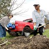 Linda Howard Brown, left, and Jean Evansmore, both from Mt. Hope, work t remove the community garden in downtown Mt. Hope on Saturday. The garden is being moved to another location in Mt. Hope. (Chris Jackson/The Register-Herald)