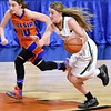 (Brad Davis/The Register-Herald) Wyoming East's Gabby Lupardus Speeds up the court during the Lady Warriors' first round win over the Rebels in the state basketball tournament Wednesday evening at the Charleston Civic Center.
