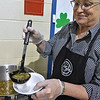 Dish Cafe's Rosy Corley pours a bowl of kale and kielbasa soup during the Empty Bowls event.
