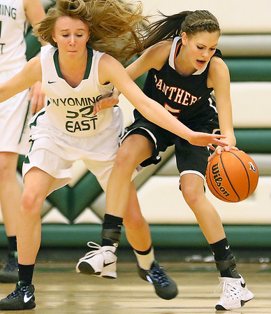 PikeView's Madison May tries to hold off Wyoming East defender Gabby Lupardus as she reaches in to try and steal the ball Friday night in New Richmond.