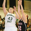 (Brad Davis/The Register-Herald) Wyoming East's Allie Lusk drives to the basket as PikeView's Kaleigh Peyton defends during the Lady Warriors' regional championship victory over the Panthers Friday night in New Richmond.
