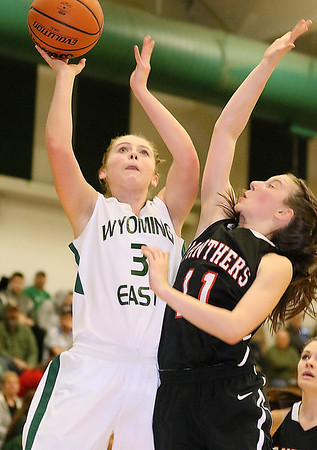 (Brad Davis/The Register-Herald) Wyoming East's Kara Sandy drives to the basket as PikeView's Ashley Scott defends during the Lady Warriors' regional championship victory over the Panthers Friday night in New Richmond.