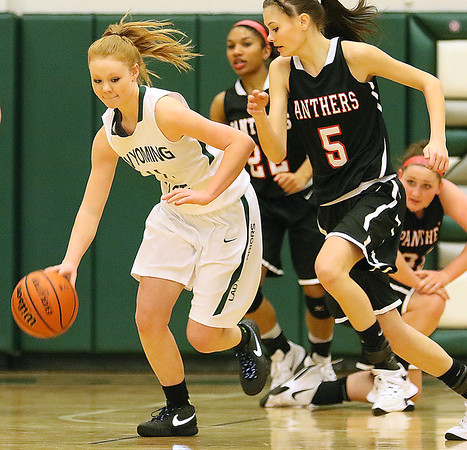 (Brad Davis/The Register-Herald) Wyoming East's Megan Davis hustles up the court as PikeView's Madison May tries to run her down during the Lady Warriors' regional championship victory over the Panthers Friday night in New Richmond.