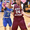 (Brad Davis/The Register-Herald)<br /> Beckley's Jonathan Moore gets a pass away to an open teammate just in time before Milton's Carter Womack can knock the ball away during a 4th grade bracket game in the annual Biddy Buddy youth basketball tournament Friday afternoon at the YMCA of Southern West Virginia.