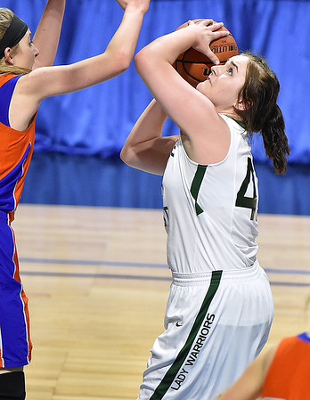 (Brad Davis/The Register-Herald) Wyoming East's Allie Lusk scores during the Lady Warriors' first round win over the Rebels in the state basketball tournament Wednesday evening at the Charleston Civic Center.