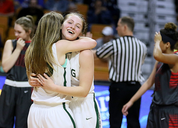 Wyoming East teammates Kara Sandy, right, and Gabby Lupardus hug each other in celebration after the Lady Warriors defeated the Sissonville Indians Friday afternoon to advance to the class AA state championship game at the Charleston Civic Center.