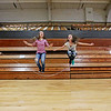 "Jessica Dial, center left, 11, and Savannah Bigham, center right, 12, jump rope together as Ashlee Taylor, left, 12, and Hannah Hunter, right, 12, turn the rope during Fayetteville Elementary's ""Jump Rope For Heart"" at the Soldier's and Sailors Memorial Building in Fayetteville on Friday. Fayetteville Elementary aimed to raise over $2,000 for the American Heart Association's fight against heart disease. (Chris Jackson/The Register-Herald)"