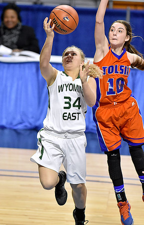 (Brad Davis/The Register-Herald) Wyoming East's Kelsey Green scores as Tolsia's Dena Jarrells during the Lady Warriors' first round win over the Rebels in the state basketball tournament Wednesday evening at the Charleston Civic Center.