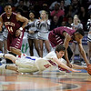 Morgantown's Nicky Soloman (15) dives for a loose ball as Woodrow Wilson's Ty Walton (12) goes for it as well during their Class AAA Semi-Finals of the West Virginia State Basketball Tournament at the Charleston Civic Center in Charleston, W.Va., on Friday, March 18, 2016. Morgantown won 54-50. (Chris Jackson/The Register-Herald)