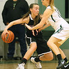 (Brad Davis/The Register-Herald) PikeView's Ashley Scott has to dribble behind her back as she tries to hold off Wyoming East defender Megan Davis Friday night in New Richmond.