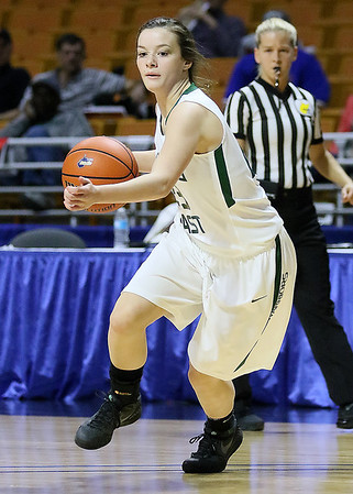 (Brad Davis/The Register-Herald) Wyoming East's Katie Daniels drives during the Lady Warriors' first round win over the Rebels in the state basketball tournament Wednesday evening at the Charleston Civic Center.