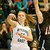 (Brad Davis/The Register-Herald) Wyoming East's Megan Davis passes to an open teammate as PikeView's Ashley Scott defends during the Lady Warriors' regional championship victory over the Panthers Friday night in New Richmond.