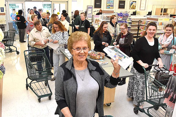 Ann Richmond, of Shady Spring, holds up a $250. gifr card she recieved during the grand opening of JoAnn Fabrics and Crafts at the former location of the Raleigh Mall in Beckley Thursday morning.<br /> Rick Barbero/The Register-Herald