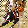 (Brad Davis/The Register-Herald) Oak Hill's Abraham Farrow drives along the perimeter as Woodrow Wilson's Ty Walton defends during the Flying Eagles' win over the Red Devils Wednesday night at the Beckley-Raleigh County Convention Center.