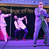 Contestants (from left) Roger Lockridge, Ashton Nelson, Benjamin Hatfield and Jason Lowe perform a routine during the group dance portion of the Women's Resource Center's Hunks in Heels event Friday night at the Beckley-Raleigh County Convention Center.