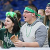 (Brad Davis/The Register-Herald) Wyoming East students react to events on the court as their Lady Warrior classmates take on the Tolsia Rebels in the first round of the girls high school state basketball tournament Wednesday evening at the Charleston Civic Center. Wyoming East would go on to win the game 64-44 and will play Friday in the next round.