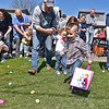 A wave of children and accompanying adults stampede onto the lawn at the Humane Society of Raleigh County Animal Shelter as the Easter egg hunt begins during the Easter Eggstravaganza Saturday afternoon.