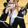 (Brad Davis/The Register-Herald) Wyoming East's Alec Lusk is mugged for the ball by Westside defenders Corey Hatfield, left, and James Colucci Saturday night at the Beckley-Raleigh County Convention Center.