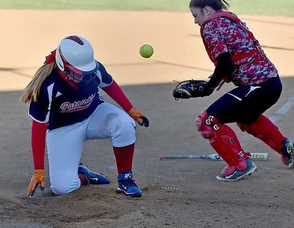 (Brad Davis/The Register-Herald) Independence's Tori Milam, left, is already home safe and getting up off the dirt by the time the throw gets in to Liberty catcher Rabekka Quarles Monday afternoon in Coal City.